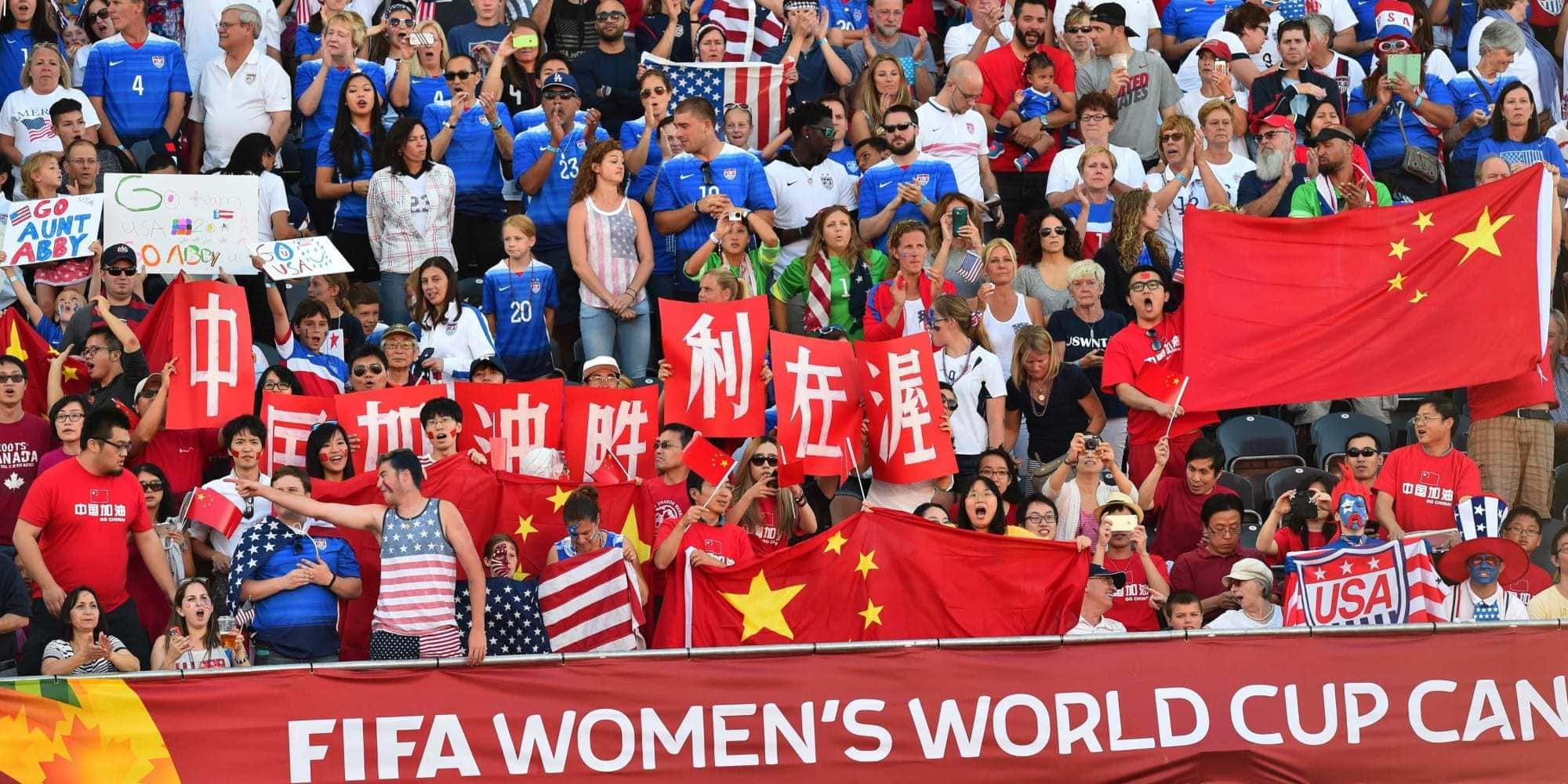 Fans of China and the US cheer before their  2015 FIFA Women's World Cup quarterfinal match between the US and China at Lansdowne Stadium in Ottawa, Ontario on June 26, 2015.    AFP PHOTO/NICHOLAS KAMM        (Photo credit should read NICHOLAS KAMM/AFP/Getty Images)